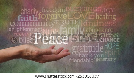 Words of Peace - Female hand outstretched with the word 'Peace' floating above, surrounded by peace related words on a wide multicolored rustic stone effect background  - stock photo