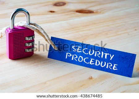Words SECURITY PROCEDURE written on tag label tied with a padlock. - stock photo