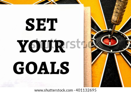 Words set your goals with dart target arrow on bullseye of dartboard, Smart goal target success business investment financial strategy concept, abstract background - stock photo