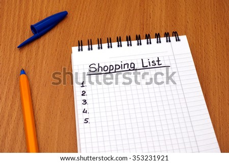 Words Shopping List written on white note pad with ballpoint pen. - stock photo