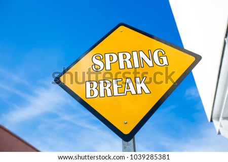 Words Spring Break on yellow road sign. Tropical street