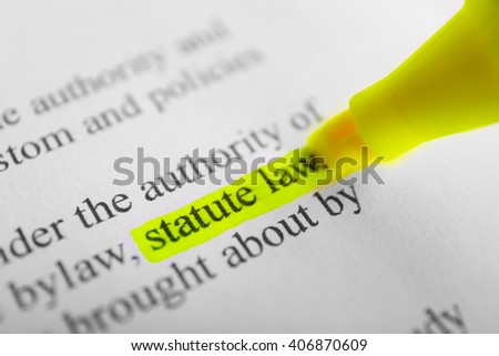 Words Statue law highlighted with a yellow marker - stock photo