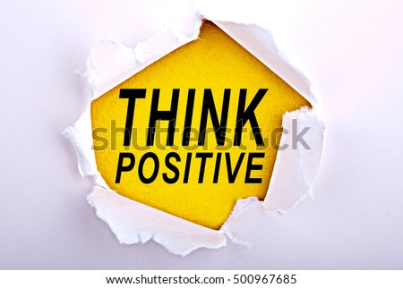 Words Think Positive on ripped paper - Business, technology, internet concept. Stock Photo