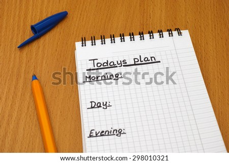 Words Todays plan, Morning, day and Evening written on white note pad with ballpoint pen.  - stock photo