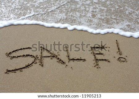 Words written in the sand on a beach - stock photo