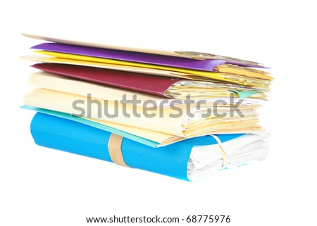 work and business files stacked high in folders isolated on white with room for your text - stock photo