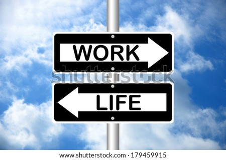 Work and Life road signs - stock photo