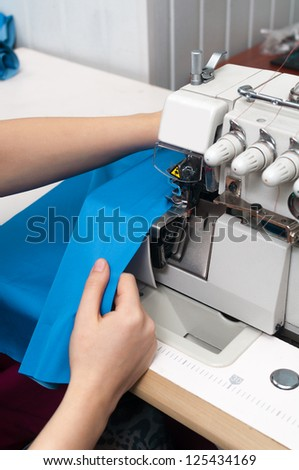 work at the sewing machine - stock photo