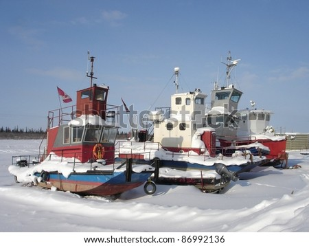 Work boats wait for the spring thaw on the east channel of the Mackenzie River near Inuvik, Northwest Territories.