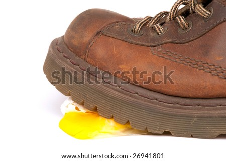 Work Boot Walking and Crushing An Egg - stock photo