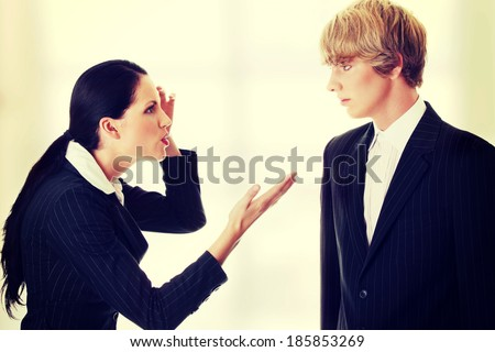 Work Colleagues arguing (woman shouting on man) - stock photo