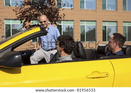 Work colleagues car pooling from the office - stock photo