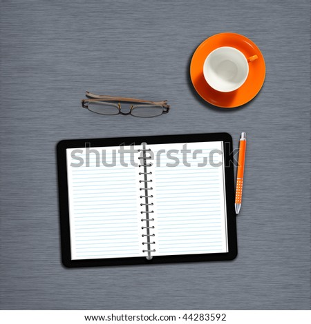 work desk with notebook, plain paper and coffeecup