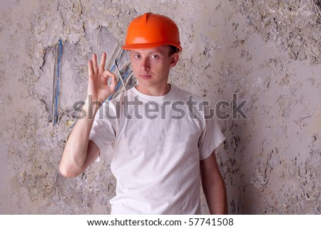 Work electrician shows approx - ok. Job well done - stock photo