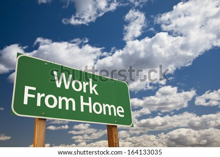 Work From Home Green Road Sign with Dramatic Clouds and Sky. - stock photo