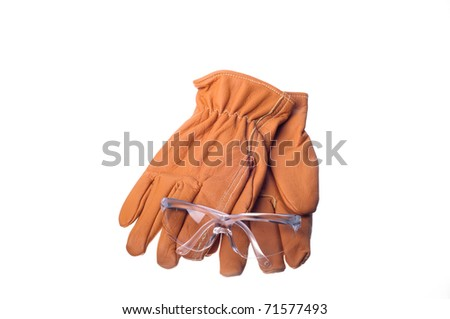 work gloves and safety glasses - stock photo