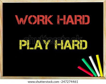 Work Hard Play Hard, vintage chalk text on blackboard, colored chalk in the corner, Lifestyle conceptual image - stock photo