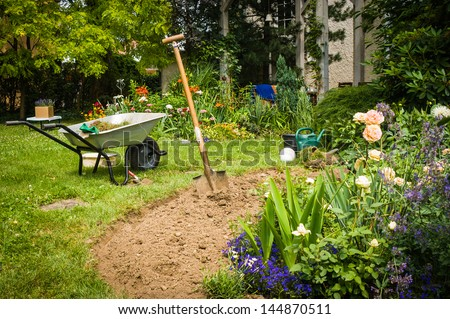 Work in garden-digging new flower beds - stock photo