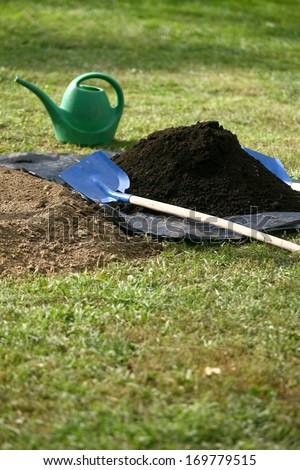 Work in garden digging new flower beds - stock photo