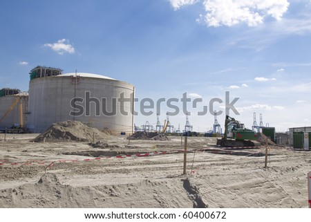 Work in progress at a oil farm. - stock photo