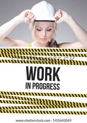 Work in progress sign on information poster and worker woman - stock photo