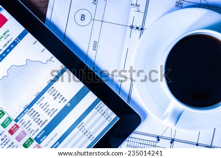 Work in the office, coffee cup with a tablet pc - stock photo