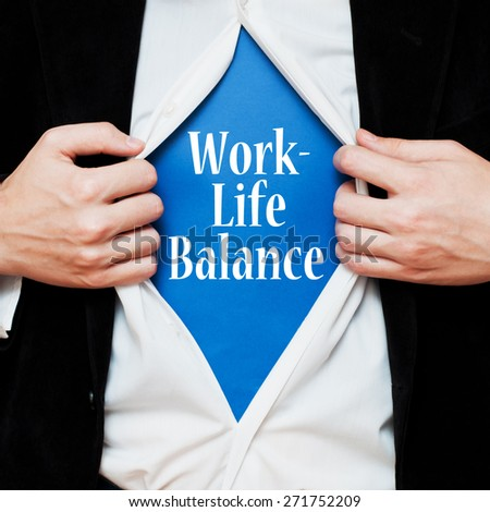 Work-Life Balance. Businessman showing a message text under his shirt like superhero, tearing his shirt off - stock photo
