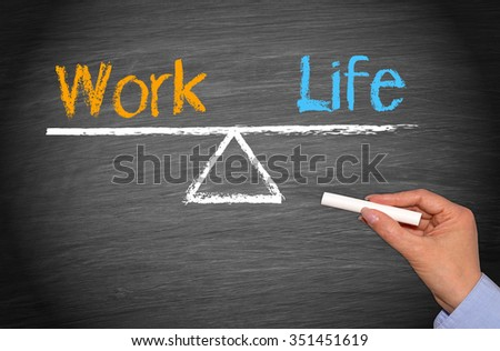 Work Life Balance concept chalkboard with female hand and chalk - stock photo