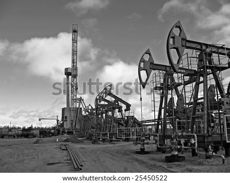 Work of oil industry. Construction and equipment of pump jack. Black and white photo - stock photo