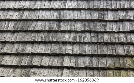 Work of traditional carpentry - roof made of wooden tiles