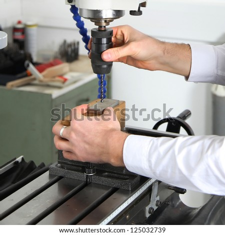 work on a milling machine - stock photo