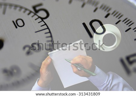 Work on an urgent project. Man takes notes in a notebook, on a background of stopwatch. Double exposure. Time is running out, and still a lot of work