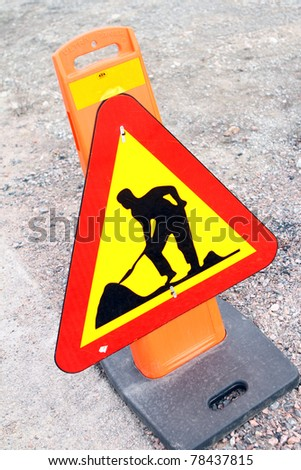 Work on road sign - stock photo