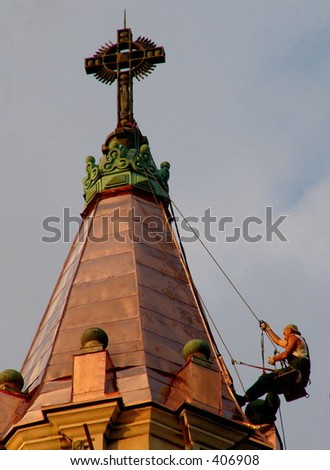 Work on the cathedral's top - stock photo