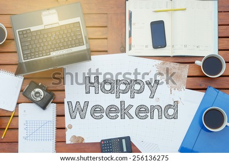 Work place concept - Office Desk with Tools and Notes About Happy Weekend with the beautiful dispersing sun light - stock photo