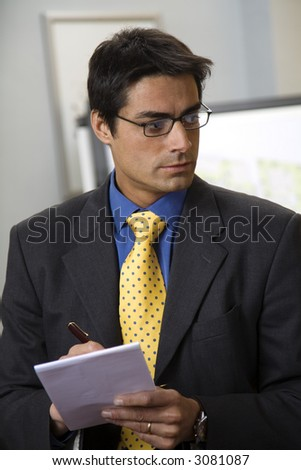work place: successful businessman taking some notes - stock photo
