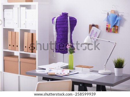 work place with sew manikins, isolated on white - stock photo
