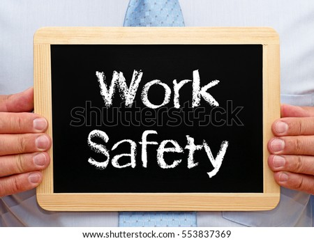 Work Safety - Businessman with chalkboard and text
