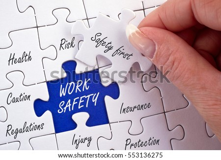 Work Safety - jigsaw concept image with female hand and text