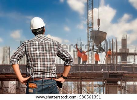 Work Safety Officer Or Civil Engineer. Team Worker On Background  Civil Engineer
