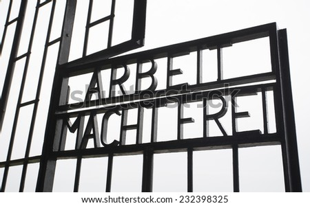 work sets you free sign on pow camp gates - stock photo