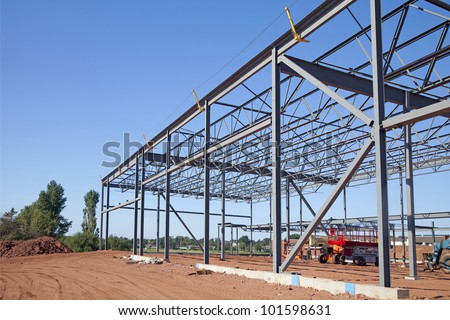 Work site and large steel frame of a large commercial building. - stock photo
