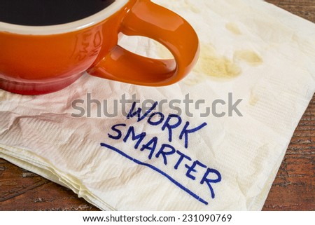 work smarter advice - handwriting on  a napkin with cup of coffee - stock photo