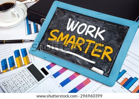 work smarter handwritten on blackboard - stock photo