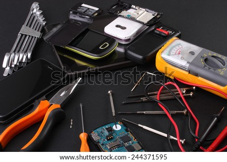 Work table for repairing mobile phones - stock photo