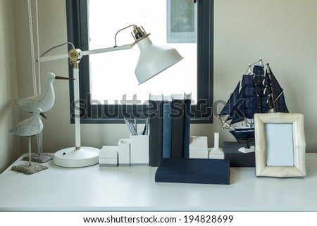 work table with lamp,pencil, book in a home  - stock photo