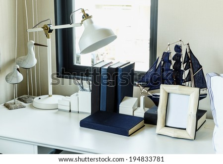 work table with lamp,pencil, books in a home  - stock photo
