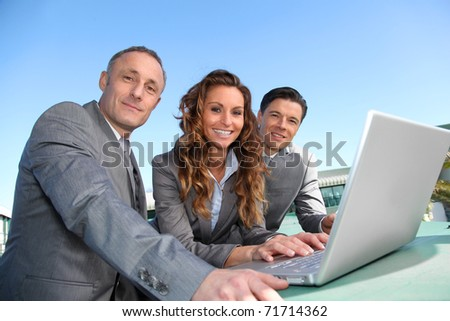Work-team during a business travel meeting - stock photo