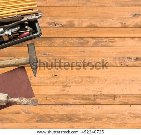 Work Tool, hammer, chisel, on a light wooden background