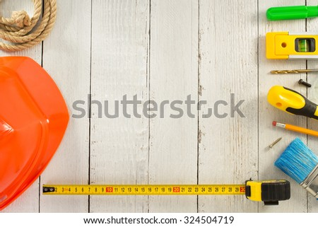 work tools and instruments on wooden background - stock photo